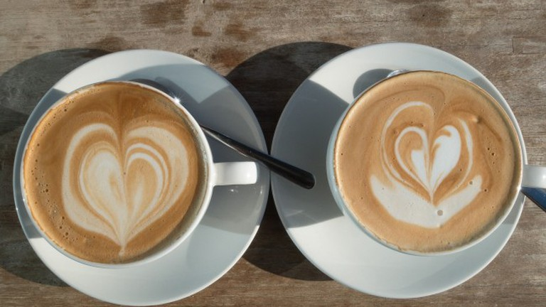 Two coffees with cream love hearts