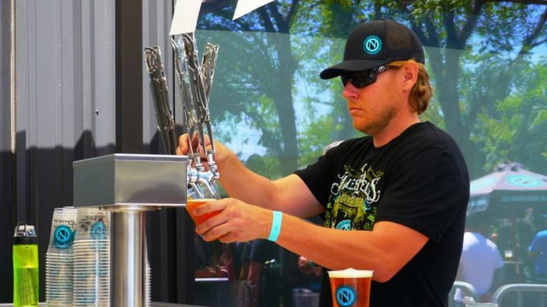 Barman pulling a pint at Ninkasi Brewery
