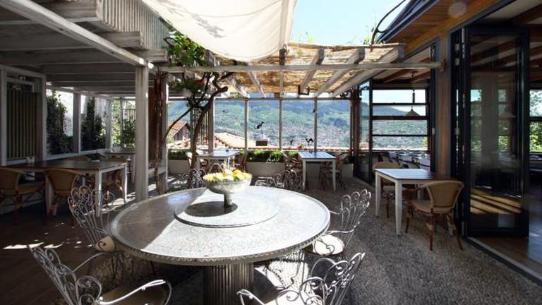On the patio of Kibe Mahala Restaurant