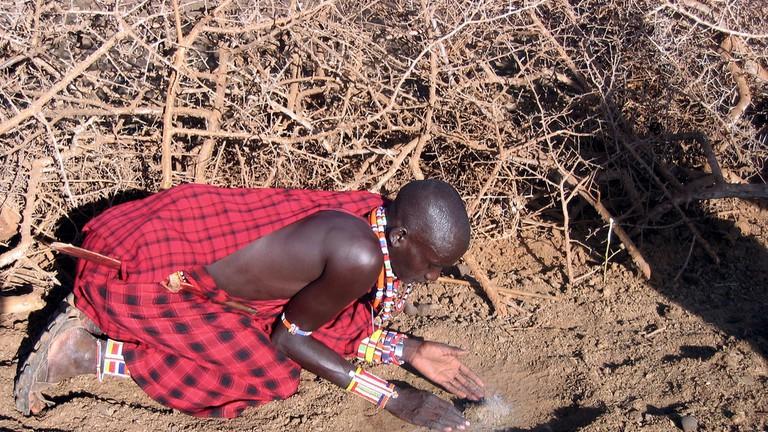 Massai preparing to make fire
