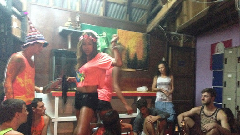 People going wild in a party hostel