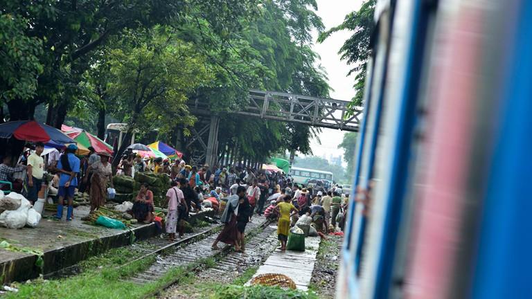 Da Nyin Gone Market spilling over train tracks near Yangon, Myanmar