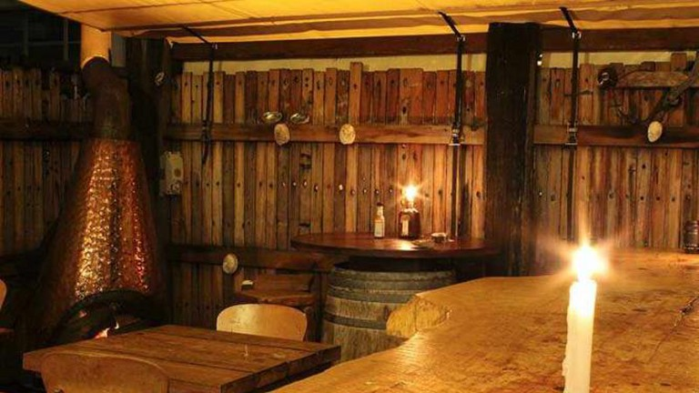 Heaven Woodfire Pizza's rustic wooden interior