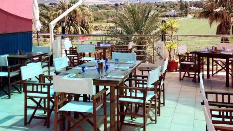 The beautiful outdoor dining area of Aqui Mediterranean Fusion Restaurant