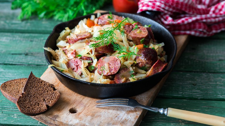 Cabbage fried with bratwurst and tomato sauce