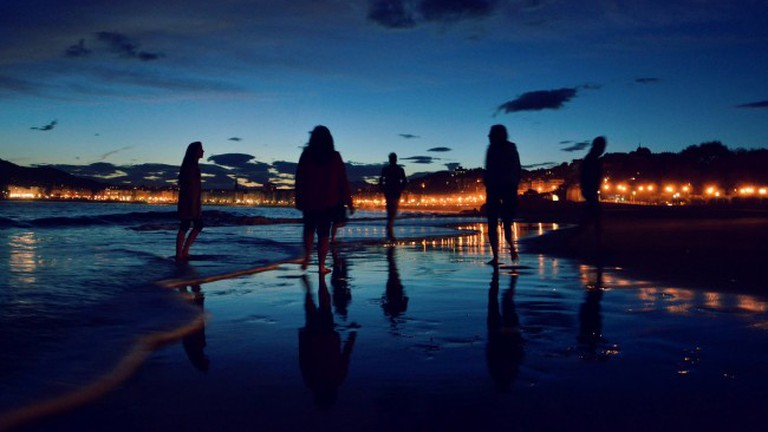 Nightlife continues on the beach in San Sebastian