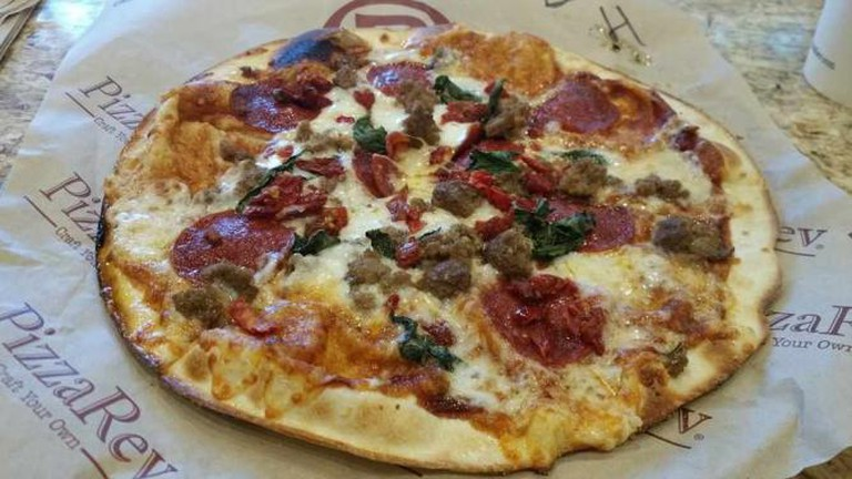 Signature dough pizza with BBQ sauce, beef pepperoni and meatballs