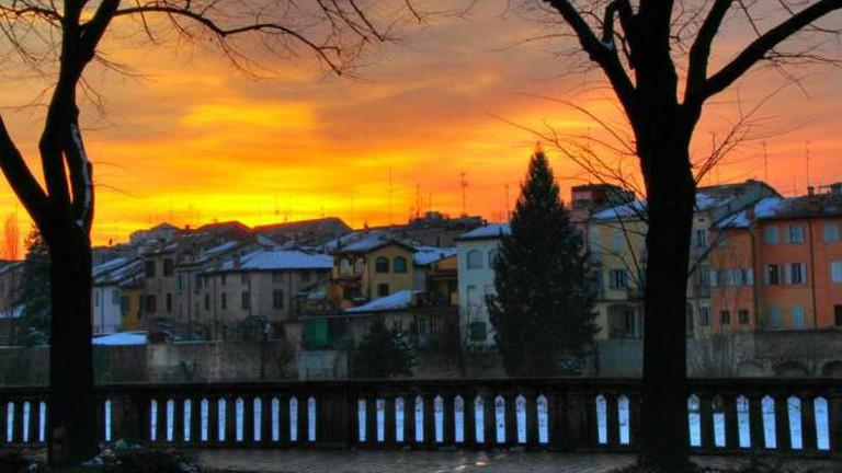 Sunset over Parma's skyline