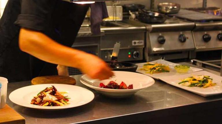 Chefs preparing food at Bistro Süd