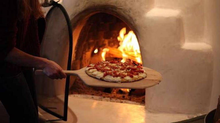Pizza baking in Woodfired oven