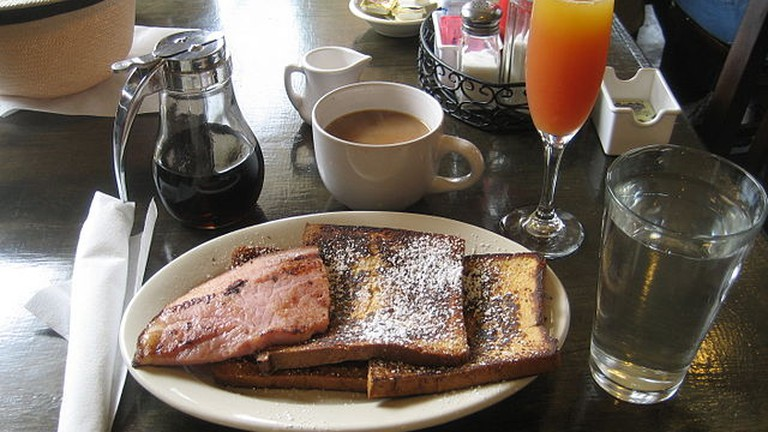 French toast, ham, coffee, and mimosa
