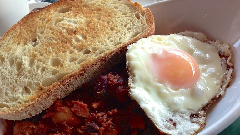Baked beans with ham hock with fried duck egg and toast