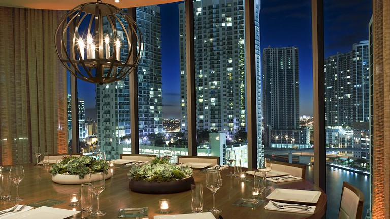 Private dining space in Area 31 at the EPIC Hotel overlooking the Miami River