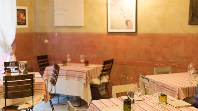 The warm and rustic, yet elegant interior of Ristorante Consorzio, Turin | Courtesy Ristorante Consorzio