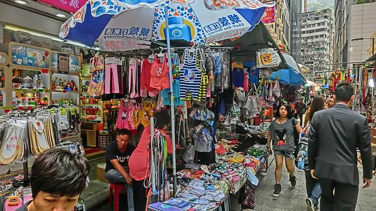 hk__wan_chai_market__tai_yuen_street_stall_sun_umbrella_n_visitors_apr-2014