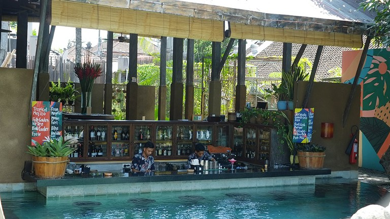 The bar and the pool at Folk Ubud