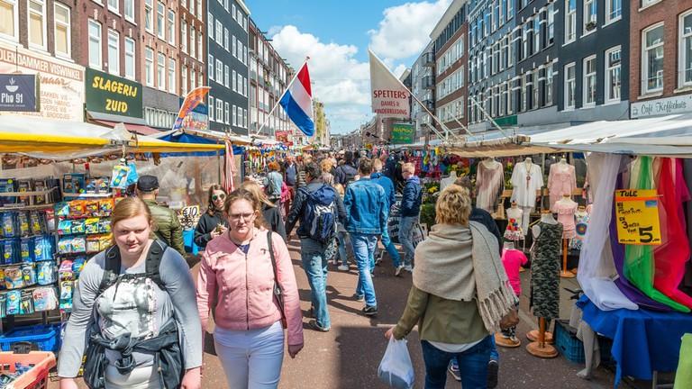 Tourists walk in Albert Cuyp Market, Amsterdam