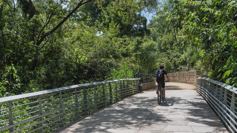 Man biking along Lady Bird Lake Boardwalk, Austin