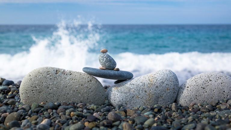 Stone surfing at Mabua Pebble Beach, Surigao, Philippines.