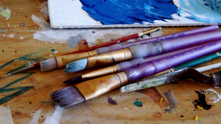 Paintbrushes and canvas on a table