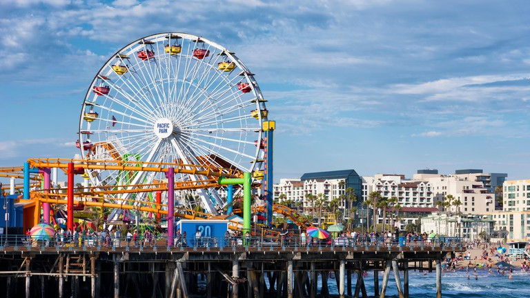 SANTA MONICA, USA - JUNE 19: The amusement park on the Santa Monica Pier, Los Angeles California on June 19, 2016. The pier is p