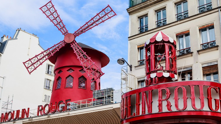 Paris, France. Moulin Rouge is a famous cabaret built in 1889, locating in the Paris red-light district of Pigalle