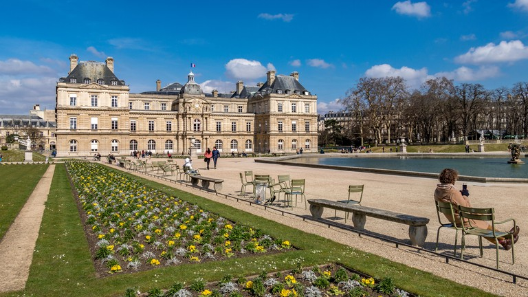 People sitting in the Jardin du Luxembourg, Paris, France.