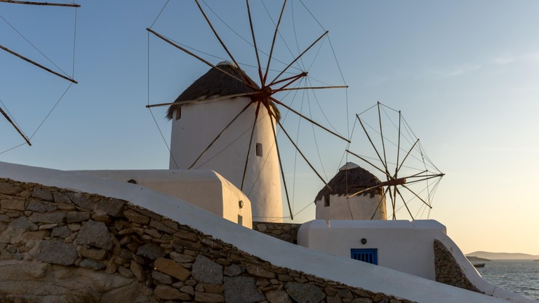 White windmills and Aegean sea on the island of Mykonos