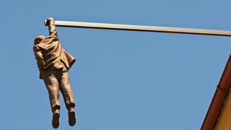 The 'Man Hanging Out' sculpture in Prague depicts the psychoanalyst Sigmund Freud