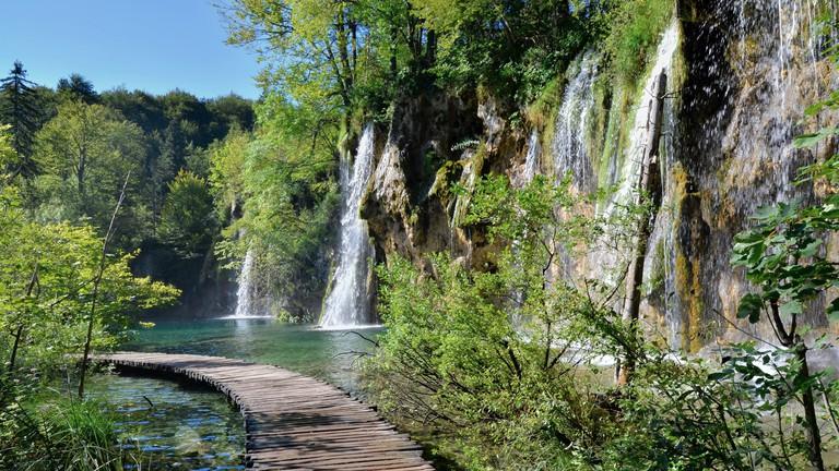 Boardwalk through the waterfalls of Plitvice Lakes National Park, Croatia.
