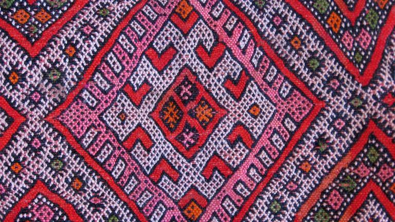 Colourful woven Berber carpet