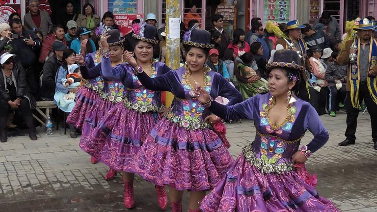 39a99298da Women from Puno wearing polleras dance at la Fiesta de la Virgen de la  Candelaria in