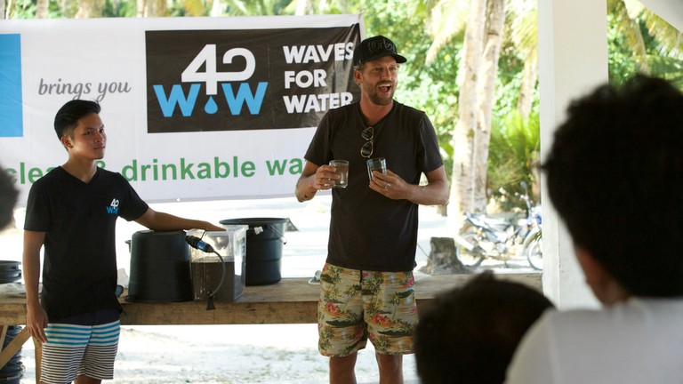 Waves For Water founder Jon Rose does a water demo in the Philippines   © Red Bull