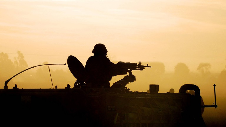 An army soldier preparing his tank and weapons at sunset   © ChameleonsEye/Shutterstock