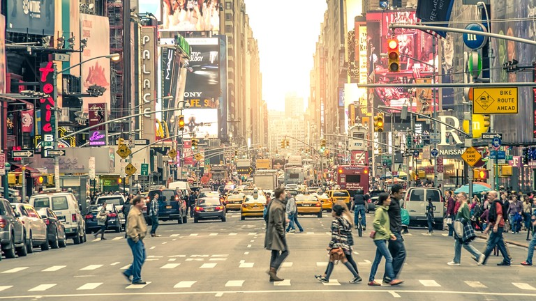 Symbolic Times Square in New York City, U.S.A., featured with Broadway Theaters and animated LED signs.