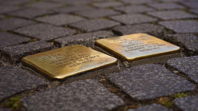 The Deeper Meaning Behind Berlin's Brass Cobblestones