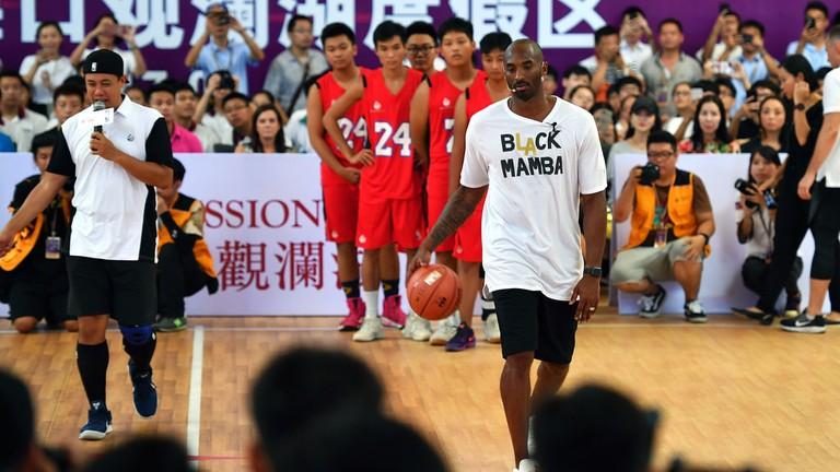 Former NBA player Kobe Bryant teaching basketball in China's Hainan Province   © Xinhua/REX/Shutterstock