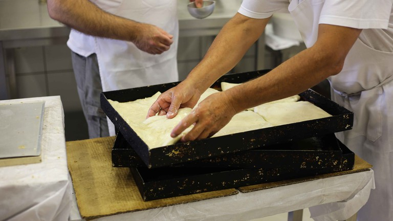 Bakers add the final touches before the bougatsa goes into the oven   © Eleni Philippou