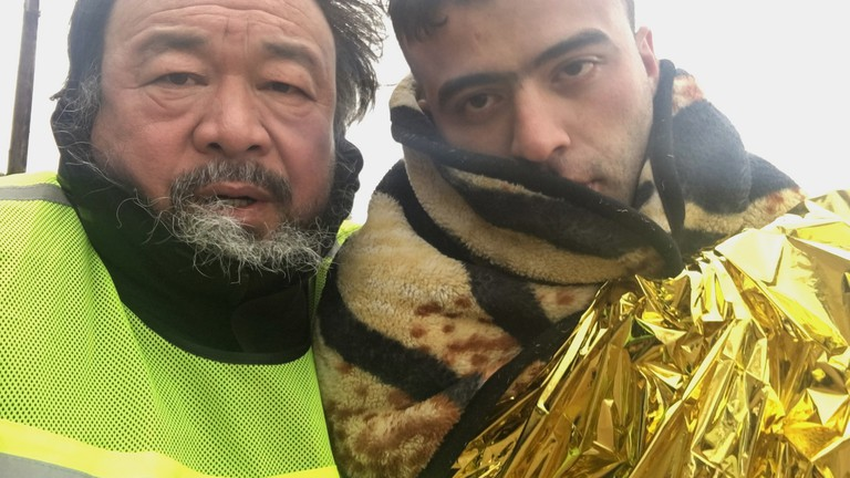 Still from Human Flow of Ai Weiwei with a migrant in Greece