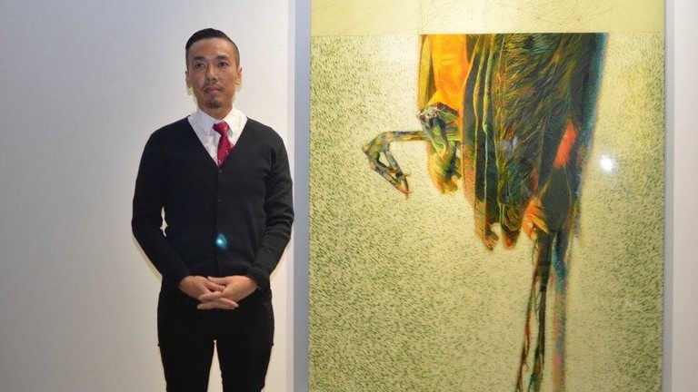 Ivan Lam with his artwork   © Wei-Ling / WikiCommons