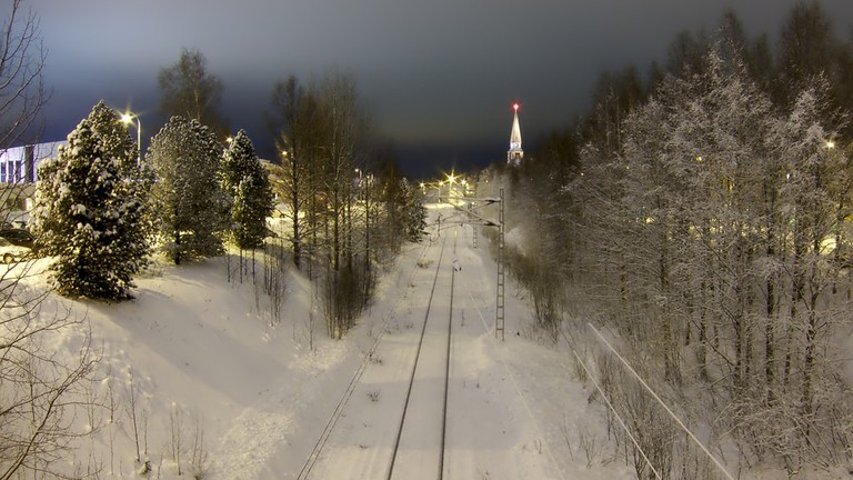 The snow-covered railway leading into Rovaniemi