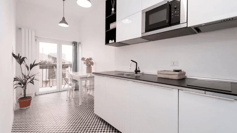 The sleek kitchen of this loft apartment in Pigneto