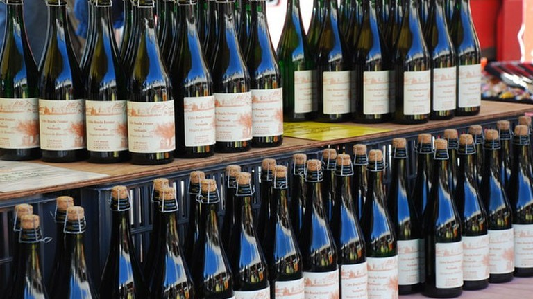 Bottles of Normandy cider on display