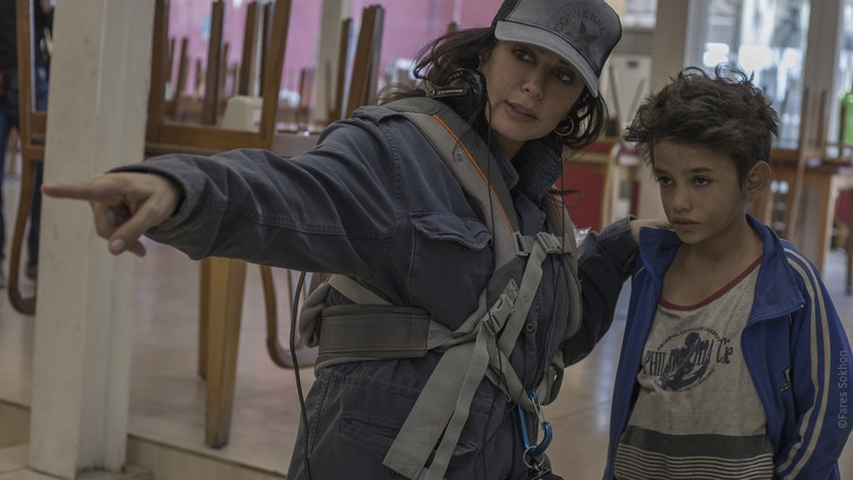 Nadine Labaki speaks with Zain Al Rafeea on the set of 'Capernaum'