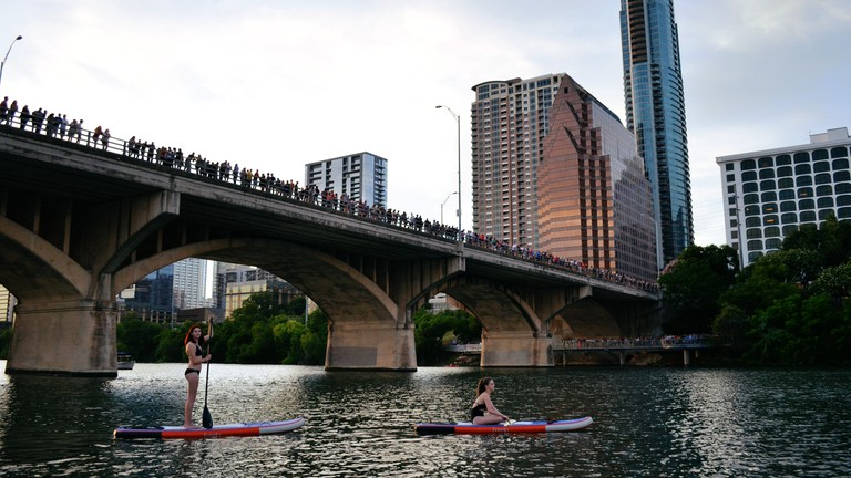 You can watch the urban bat colony emerging from beneath the Congress Avenue Bridge to feed at night