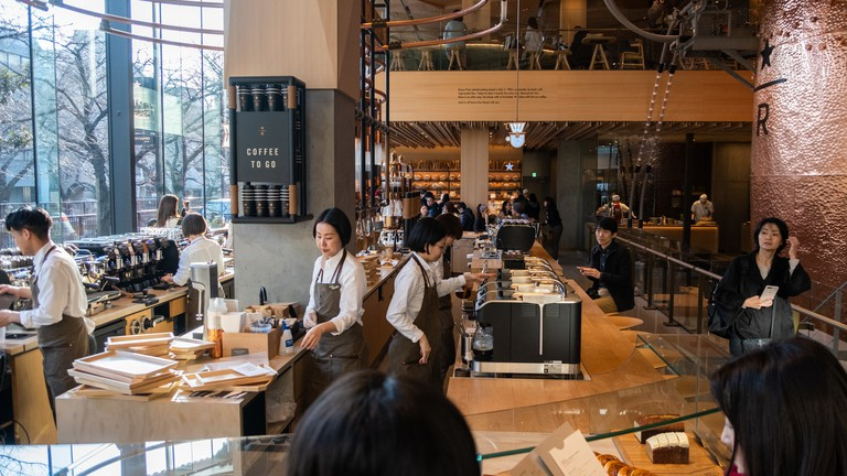 Customers at the busy Starbucks Reserve Roastery coffee house in Tokyo