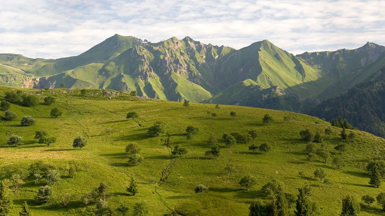 The rugged Auvergne region features rolling hills and vineyards