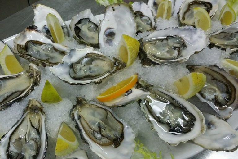 The menu's highlights include fresh local oysters, carpaccio, locally smoked steelhead and BLT