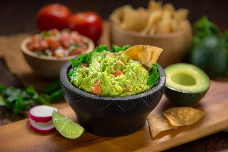 Guacamole with tortilla chips and salsa