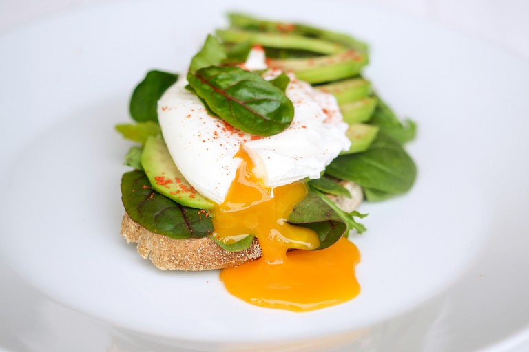 Breakfast with Wholemeal Bread Toast and Poached Egg with Green Salad, Avocado